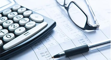 Calculator, pen and glasses